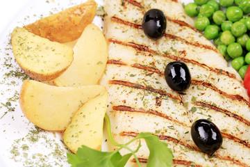Fried fish fillet with vegetables.