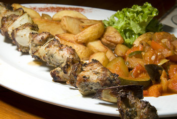 Polish shish kebab shashlik ajapsandali fried potatoes and veget