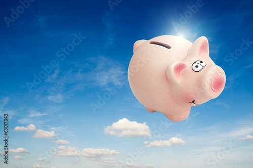 piggy bank in air