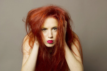 wild red hair woman staring