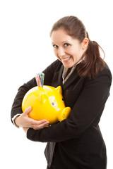 Geschäftsfrau hält Sparschwein