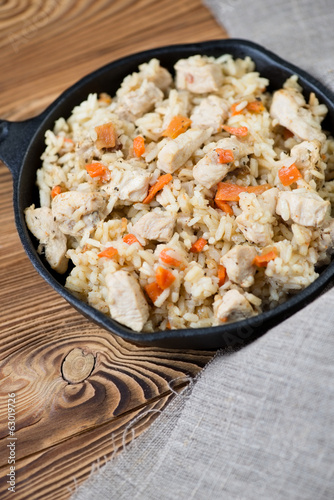 Pilaf with chicken, vertical shot, close-up