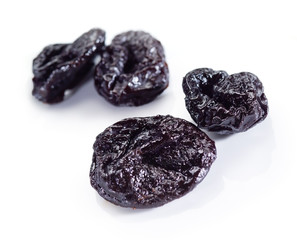Dried plums. Prunes isolated on white.