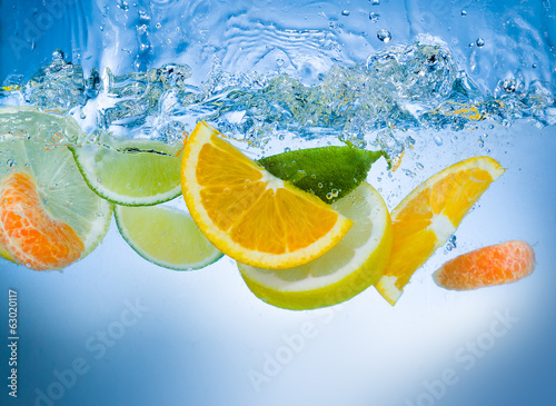 Fruits in water. Big splash