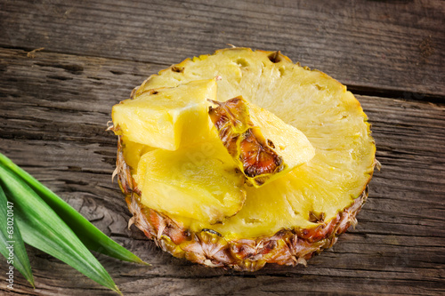 Pineapple. Slice and chunks on wooden table