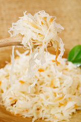 Sour cabbage - sauerkraut - on wooden spoon
