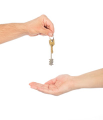 Male hand holding a car key and handing it over to another perso