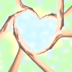 Human hands in heart shape over bright background