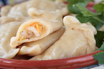 Dumplings with sauerkraut and lard in bowl