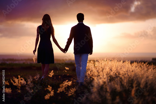 Young couple enjoying the sunset