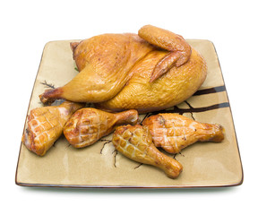 smoked chicken on a plate on white background