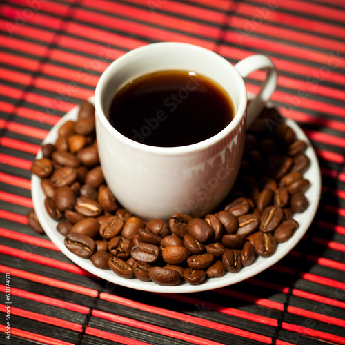 Coffee cup and beans on a table