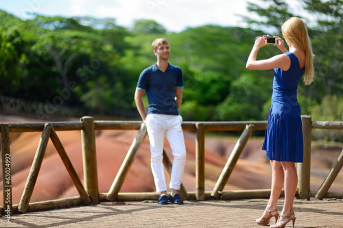Young couple sightseeing Chamarel coloured earths