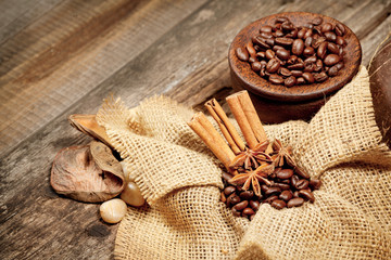 Cinnamon, star anise and coffee beans on old wooden table