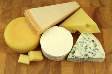 Various cheeses on a kitchen board
