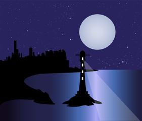 città sulla costa e faro nella notte