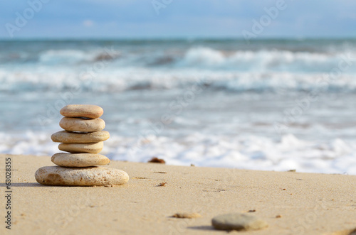 Stack of pebbles at the sea coast