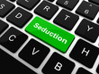 Seduction word button on keyboard with soft focus