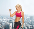 young sporty woman with light dumbbells