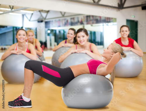 smiling woman with fitness ball