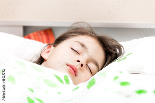 little girl sleep in the bed