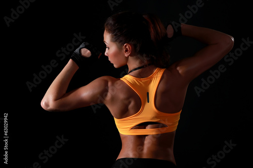 Young attractive female fitness model posing