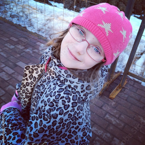 Adorable kid girl in pink hat