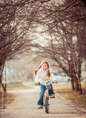 little girl on a bicycle