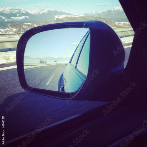 free highway/motorway in a mirror of blue modern car