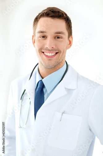 young male doctor with stethoscope in hospital