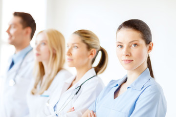 female doctor or nurse in front of medical group