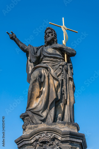 Statue of Jesus on Charles Bridge in Prague, Czech Republic.