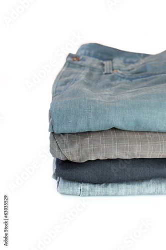 stack of verious denim clothes isolated