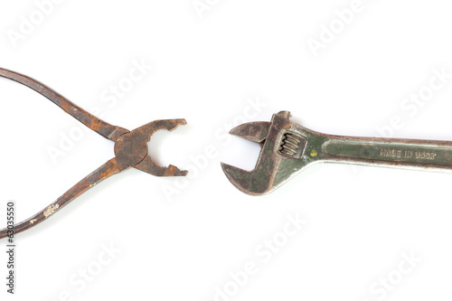 isolated vintage pliers and wrench  on white