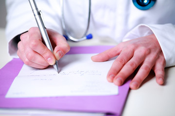 Photography closeup of a female doctor writing a prescription