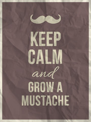 Keep calm and grow a mustache quote on crumpled paper texture