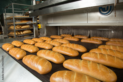 Fotobehang Bakkerij Hot baked breads on a line