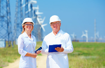 researchers on wind power station
