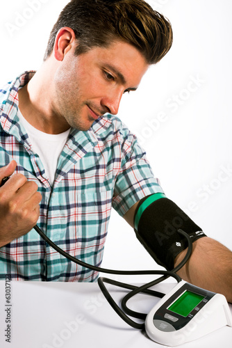 Man taking his blood pressure reading.