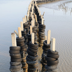 Wave barrier made from many old tires, Protection