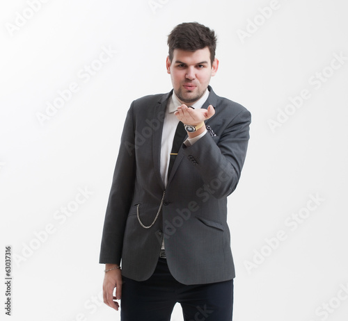 Handsome man makes a gesture with his hand.