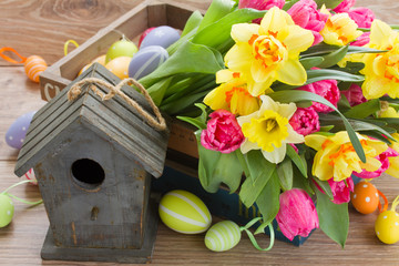 birdcage with tulips and daffodils