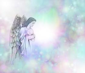 Angel on soft misty bokeh frame background