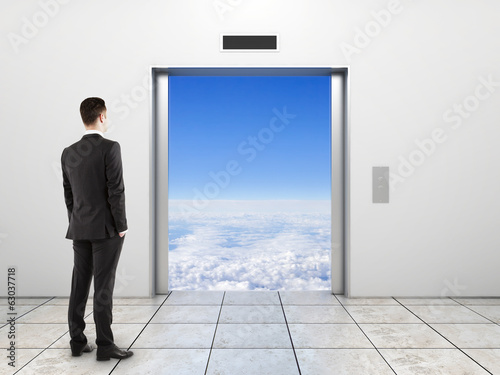 businessman looking to elevator
