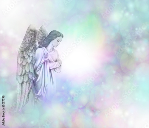 Angel on soft misty bokeh frame background