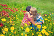 Happy mother and daughter hugging in flower meadow