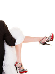 Wedding. Fashionable high heels of bride isolated