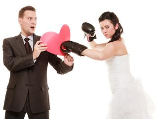 Wedding couple. Bride boxing heart of groom.