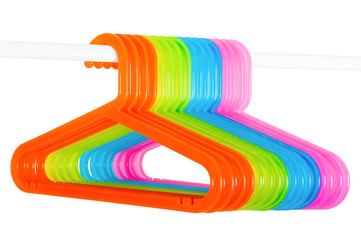 Colored hangers on a rod isolated on white