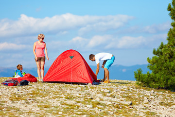 family set up a camp in mountains, active lifestyle